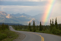 Rainbow over the Alaska mountain range in Denali national park.