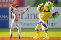 Hagerstown Suns shortstop Rick Hague #18 dances with Birdzerk! at NewBridge Bank Park July 30, 2010, in Greensboro, North Carolina.  Photo by Brian Westerholt / Four Seam Images