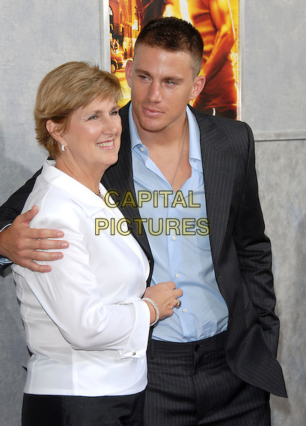 "CHANNING TATUM & GUEST.World Premiere of ""Step Up"" held at The Arclight Cinemas in Hollywood, California, USA..August 7th, 2006.Ref: DVS.half length blue pinstripe suit jacket white top.www.capitalpictures.com.sales@capitalpictures.com.©Debbie VanStory/Capital Pictures"