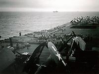 Wade Litzinger and the Division V50 ordnance men sorting ammo on flight deck of Shangri-La after the war had ended  -  Sept. 15, 1945