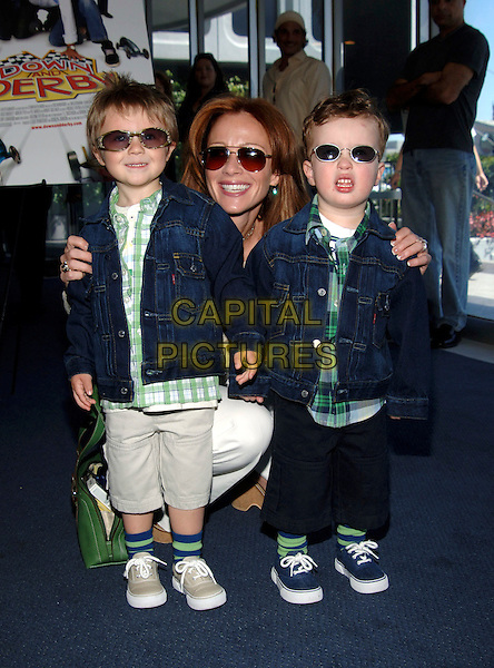 "LAUREN HOLLY, AZUR & GEORGE.""Down And Derby"" Premiere held at the Harmony Gold Theatre. .Photo Credit: Jacqui Wong/AdMedia.April 9th, 2005.full length sons family mother children kids denim jean jackets sunglasses shades matching coordinating outfits.www.capitalpictures.com.sales@capitalpictures.com.© Capital Pictures."