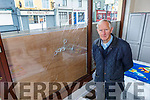 Dom O'Donnell standing inside his shop where seven of his windows were vandalised on Tuesday morning.