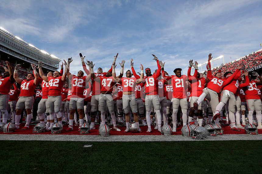 "Ohio State Buckeyes players sing ""Carmen Ohio"" following their 48-3 win over Michigan State in the NCAA football game at Ohio Stadium in Columbus on Nov. 11, 2017. [Adam Cairns/Dispatch]"