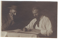 13a. (cont.)<br /> <br /> 2 5/16 x 3 1/2 [sepia]<br /> <br /> double of Sam Crone, dressed similarly in each pose, at small table; frontal figure, wearing pork-pie hat and small bow tie, with right hand at lapel of closed jacket, left; three-quarter figure with open jacket, looking to the left, holding sheets of paper. right.
