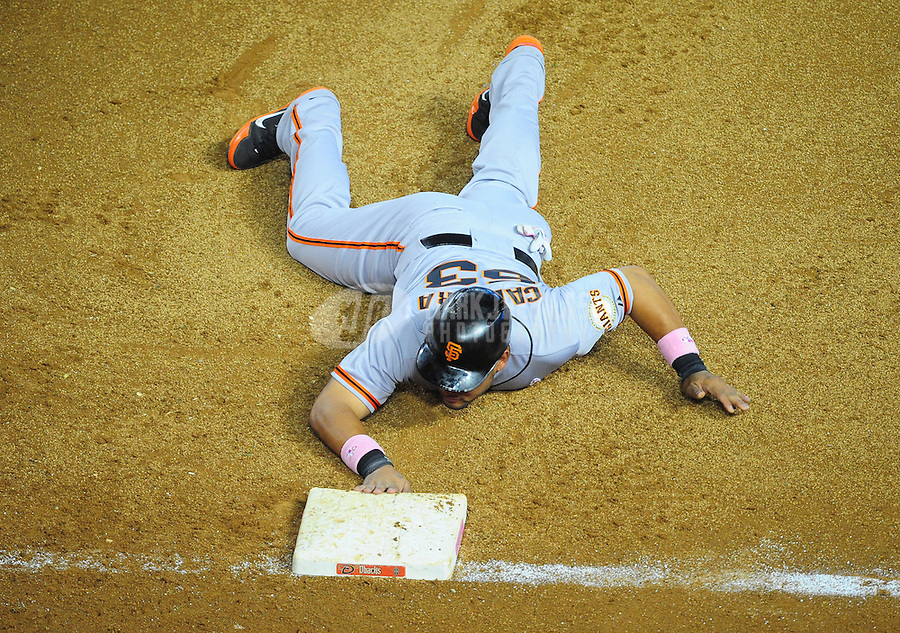 May 13, 2012; Phoenix, AZ, USA; San Francisco Giants base runner Melky Cabrera lays on the ground after a pick off attempt in the sixth inning against the Arizona Diamondbacks at Chase Field. Mandatory Credit: Mark J. Rebilas-