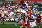 Marcelo Saragosa, FC Dallas gives Brian McBride, Chicago Fire a face full of elbow.