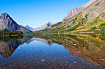 Reflections of the trees and mountains can be seen in a lake in Glacier National Park in Montana.