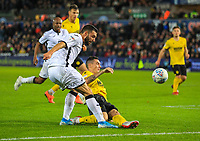 23rd November 2019; Liberty Stadium, Swansea, Glamorgan, Wales; English Football League Championship, Swansea City versus Millwall; Borja Baston of Swansea City crosses the ball despite the attempted tackle by Shaun Williams of Millwall - Strictly Editorial Use Only. No use with unauthorized audio, video, data, fixture lists, club/league logos or 'live' services. Online in-match use limited to 120 images, no video emulation. No use in betting, games or single club/league/player publications