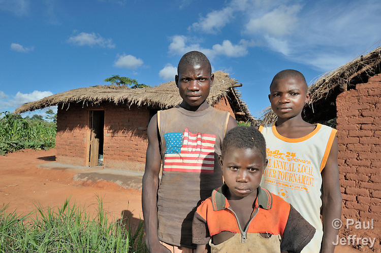 A child-headed household in Nkholongo, Malawi, where both parents died of AIDS-related diseases. Left to right: Gelson Nyoni, 18; Pilirani Ester, 6; and Titani, 15.