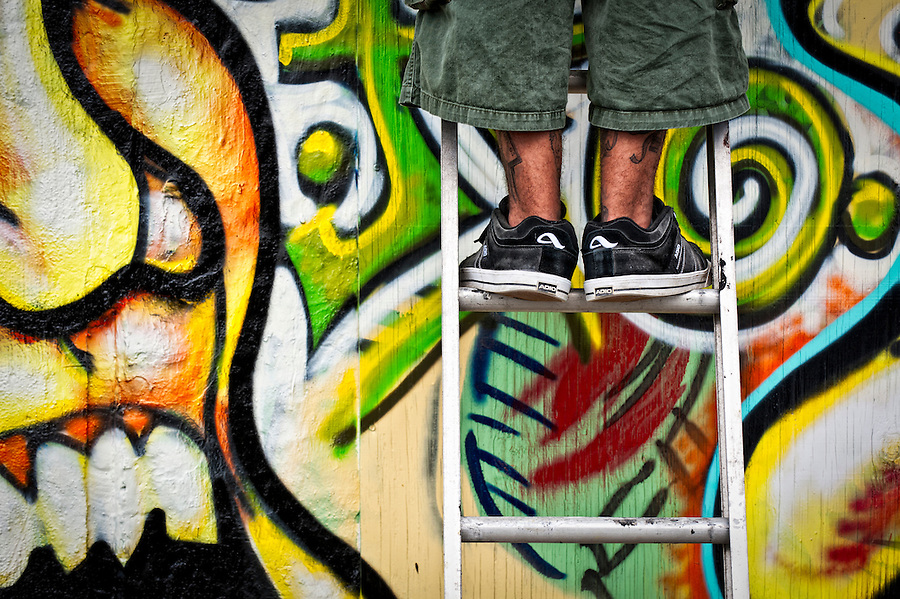 Graffiti artist in lader during Fort Lauderdale 2011 Graffiti Festival. Editorial Use Only.