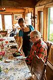 USA, Alaska, Homer, China Poot Bay, Kachemak Bay, dinner being served at the Kachemak Bay Wilderness Lodge