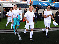 (L-R) Roger Freestone, Alan Curtis and James Thomas of Swansea Legends exits the tunnel during the Alan Tate Testimonial Match, Swansea City Legends v Manchester United Legends at the Liberty Stadium, Swansea, Wales, UK