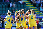 The Hague, Netherlands, June 12: Anna Flanagan #9 of Australia is congratulated by teammates during the field hockey semi-final match (Women) between USA and Australia on June 12, 2014 during the World Cup 2014 at Kyocera Stadium in The Hague, Netherlands. Final score after full time 2-2 (0-1). Score after shoot-out 1-3. (Photo by Dirk Markgraf / www.265-images.com) *** Local caption *** Casey Eastham #4 of Australia, Ashleigh Nelson #8 of Australia, Anna Flanagan #9 of Australia, Madonna Blyth #12 of Australia, Emily Hurtz #17 of Australia
