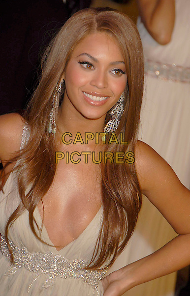 BEYONCE KNOWLES.The 2007 Vanity Fair Oscar Party Hosted by Graydon Carter held at Morton's, West Hollywood, California, USA, 25 February 2007..oscars half length gold beige dress hands on hips cleavage.CAP/ADM/GB.©Gary Boas/AdMedia/Capital Pictures.