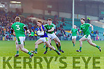 James O'Donoghue Kerry in action against Johnny McCarthy and Paul White Limerick in the Final of the McGrath Cup at the Gaelic Grounds on Sunday.