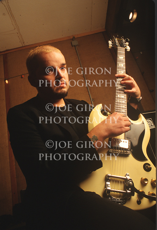 Various portraits & live photographs of the rock band, Eleven.