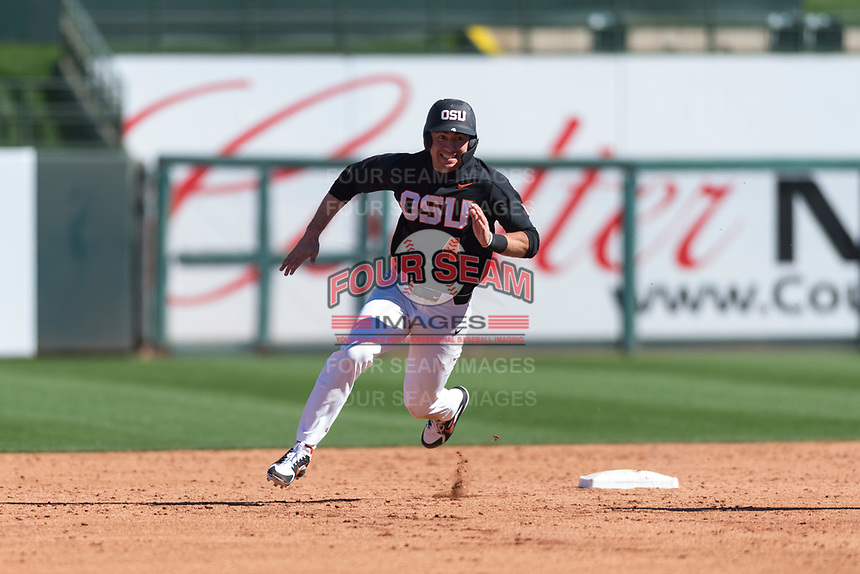 Oregon State Beavers shortstop Beau Philip (4) hustles around second base during a game against the Gonzaga Bulldogs on February 16, 2019 at Surprise Stadium in Surprise, Arizona. Oregon State defeated Gonzaga 9-3. (Zachary Lucy/Four Seam Images)