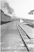 Looking westward from in front of the D&amp;RG La Veta Pass depot at the summit.  A meet between a westbound freight and an oncoming train is taking place.  The depot train order signal is set to &quot;STOP.&quot;<br /> D&amp;RG  La Veta Pass (later Fir), CO  Taken by Lively, Ken R.