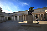 A still photographer focuses on Rodin's thinker in the courtyard of the Legion of Honor in San Francisco, California...
