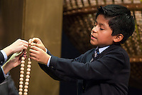 San Ildefonso child inserting one of the smaller prices