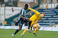Rory Gaffney of Bristol Rovers holds off Anthony Stewart of Wycombe Wanderers Wycombe Supporters during the Sky Bet League 2 match between Wycombe Wanderers and Bristol Rovers at Adams Park, High Wycombe, England on 27 February 2016. Photo by Claudio Nako.