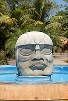 Olmec stone head and fountain  in Playa del Carmen, Riviera Maya, Quintana Roo, Mexico.