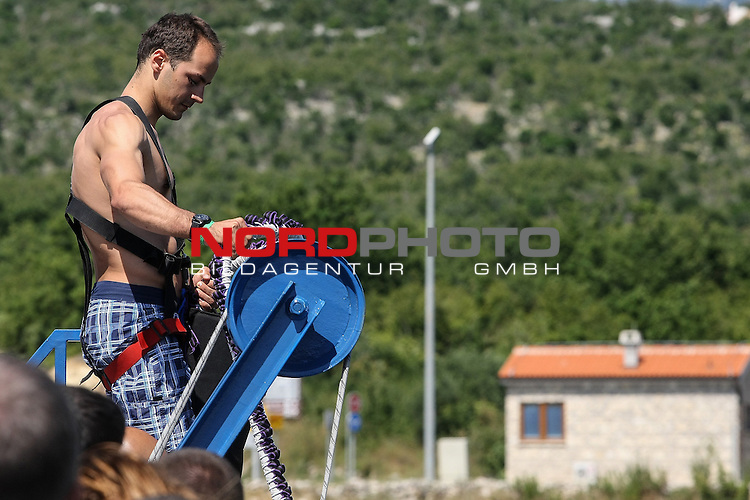 28.06.2014., Maslenica, Croatia - Gymnast Marijo Moznik during a bungee jump off the Maslenica Bridge (56 meters). He performed a double somersault with a dive into the sea. Maslenica Bridge offers the highest bungee jumping in Croatia. <br />   Foto &copy; nph /  Dino Stanin
