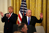 United States President Donald J. Trump applauds Israel's Prime Minister Benjamin Netanyahu acknowledges guest during a meeting in the East Room of the White House in Washington, D.C.,on Tuesday, January 28, 2020. Credit: Joshua Lott / CNP