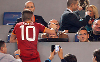 Calcio, Serie A: Roma vs ChievoVerona. Roma, stadio Olimpico, 31 ottobre 2013.<br /> AS Roma forward Francesco Totti, right, sits on the stand during the Italian Serie A football match between AS Roma and ChievoVerona at Rome's Olympic stadium, 31 October 2013.<br /> UPDATE IMAGES PRESS/Riccardo De Luca