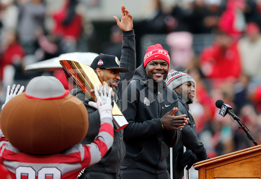 Quarterbacks Braxton Miller, Cardale Jones and J.T. Barrett stand together during the Ohio State football National Championship celebration at Ohio Stadium on Saturday, January 24, 2015. (Columbus Dispatch photo by Jonathan Quilter)