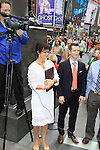 As The World Turns' Colleen Zenk and Eric on August 18, 2012 in Times Square, New York City, New York. (Photos by Sue Coflin/Max Photos)