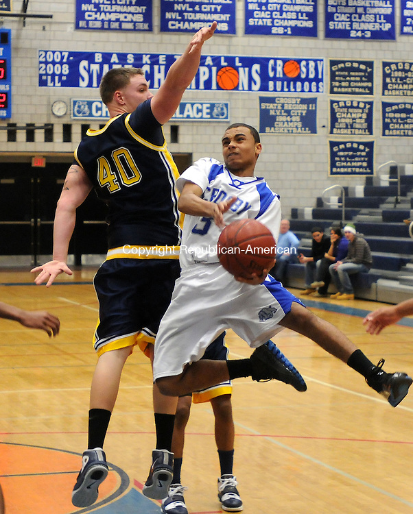 WATERBURY, CT, 03 FEBRUARY 2011-020311JS10-- Crosby's Gabe Pulliam (3) lays up a shot under the reach of Kennedy's Cody Fitzgerald (40) during their game Thursday at Crosby High School in Waterbury. <br /> Jim Shannon Republican-American