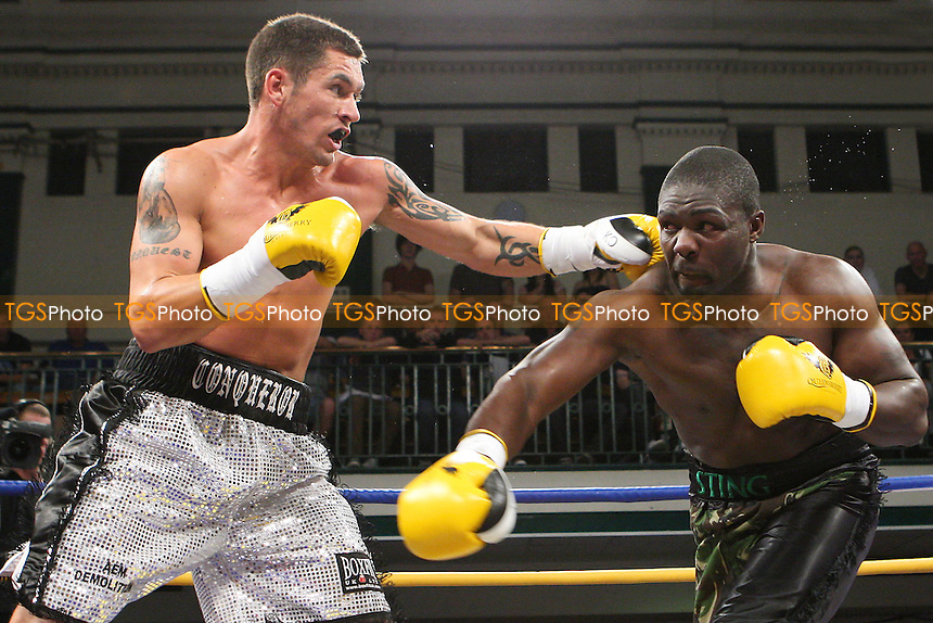 Tony Conquest (silver shorts) defeats Hastings Rasani (camouflage shorts) in a Cruiserweight Boxing Contest at York Hall, Bethnal Green, promoted by Queensberry Promotions - 30/09/11 - MANDATORY CREDIT: Gavin Ellis/TGSPHOTO - Self billing applies where appropriate - 0845 094 6026 - contact@tgsphoto.co.uk - NO UNPAID USE.