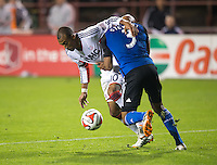 Santa Clara, California -Saturday, March 29, 2014: Teal Bunbury of NE Revolution stays in control while being harassed by Jordan Stewart of SJ Earthquakes during a match at Buck Shaw Stadium. Final Score: SJ Earthquakes 1, NE Revolution 2