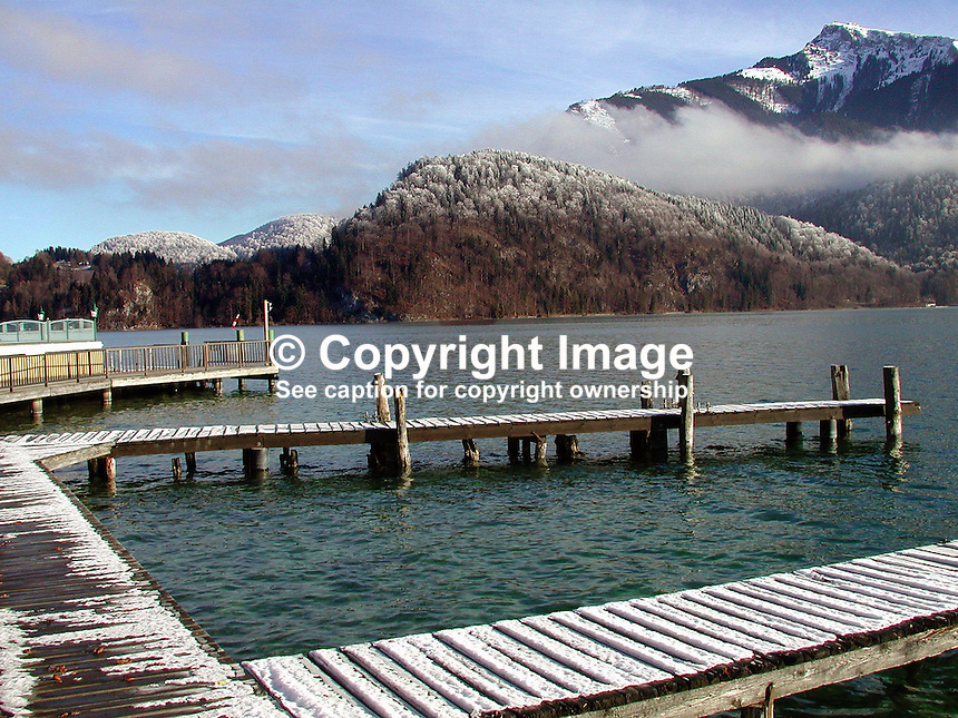 Winter, lake, mountain, view, jetty, St Gilgen, Salzburg, Austria, snow, 2000121307..Copyright Image from Victor Patterson, 54 Dorchester Park, Belfast, UK, BT9 6RJ..Tel: +44 28 9066 1296.Mob: +44 7802 353836.Voicemail +44 20 8816 7153.Skype: victorpattersonbelfast.Email: victorpatterson@mac.com.Email: victorpatterson@ireland.com (back-up)..IMPORTANT: If you wish to use this image or any other of my images please go to www.victorpatterson.com and click on the Terms & Conditions. Then contact me by email or phone with the reference number(s) of the image(s) concerned.