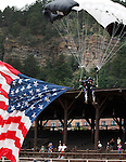 DEADWOOD, SD - AUGUST 8: Double amputee Sergeant 1st Class Dana Bowman (retired) parachutes with a large American Flag to start the opening ceremonies at the Iron Horse Rodeo held at the Days of 76 Rodeo Grounds Saturday. (Photo by Richard Carlson/dakotapress.org)