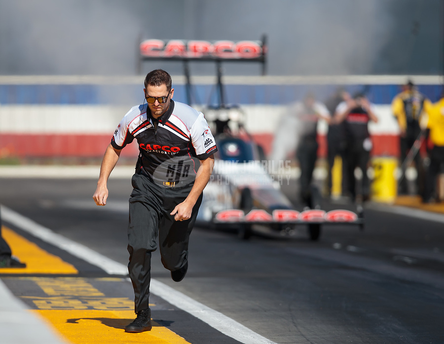 Feb 8, 2019; Pomona, CA, USA; Gary Pritchett, crew member for NHRA top fuel driver Steve Torrence during qualifying for the Winternationals at Auto Club Raceway at Pomona. Mandatory Credit: Mark J. Rebilas-USA TODAY Sports