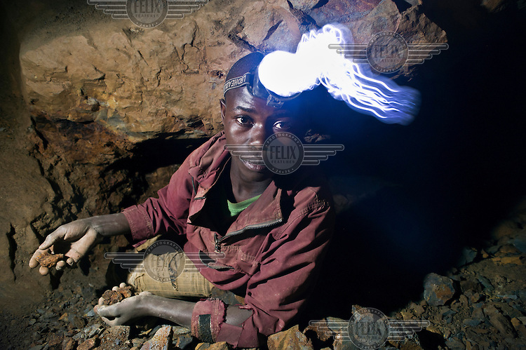A miner at work in Nyabibwe where many tons of coltan are being excavated. Coltan (columbite-tantalite) is a precious mineral used to make consumer electronic products. Many accidents happen in the mines because of collapsing tunnels and toxic gases.