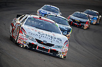 Apr 17, 2009; Avondale, AZ, USA; NASCAR Nationwide Series driver Joey Logano leads a pack of cars during the Bashas Supermarkets 200 at Phoenix International Raceway. Mandatory Credit: Mark J. Rebilas-