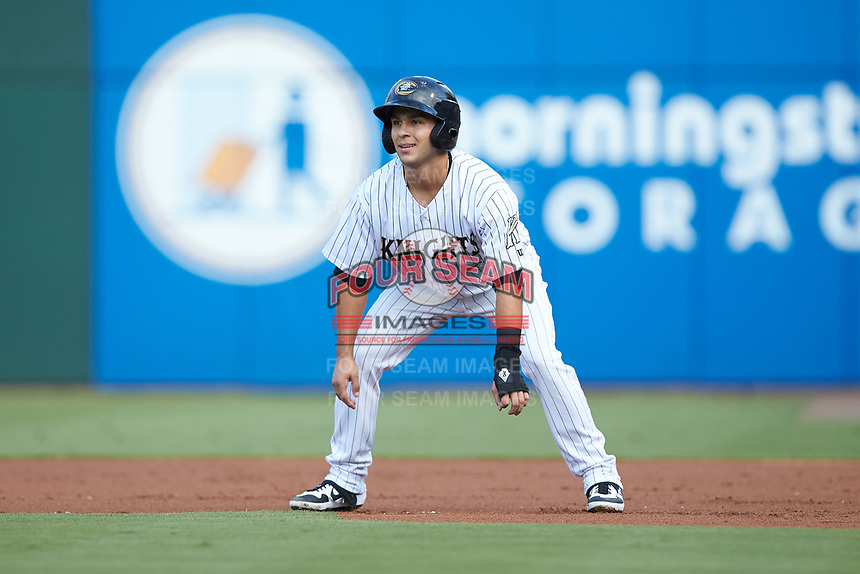 Nick Madrigal (3) of the Charlotte Knights takes his lead off of first base against the Scranton/Wilkes-Barre RailRiders at BB&T BallPark on August 14, 2019 in Charlotte, North Carolina. The Knights defeated the RailRiders 13-12 in ten innings. (Brian Westerholt/Four Seam Images)