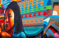 Albuguergue New Mexico Route 66 painted mural of Navajo American Indian girl with color off of Central Avenue artwork