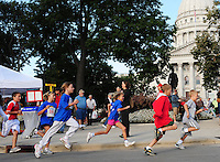Kids run around the Capitol Square during Fit Kids on Saturday in Madison