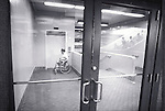amputee in wheelchair waiting for elevator