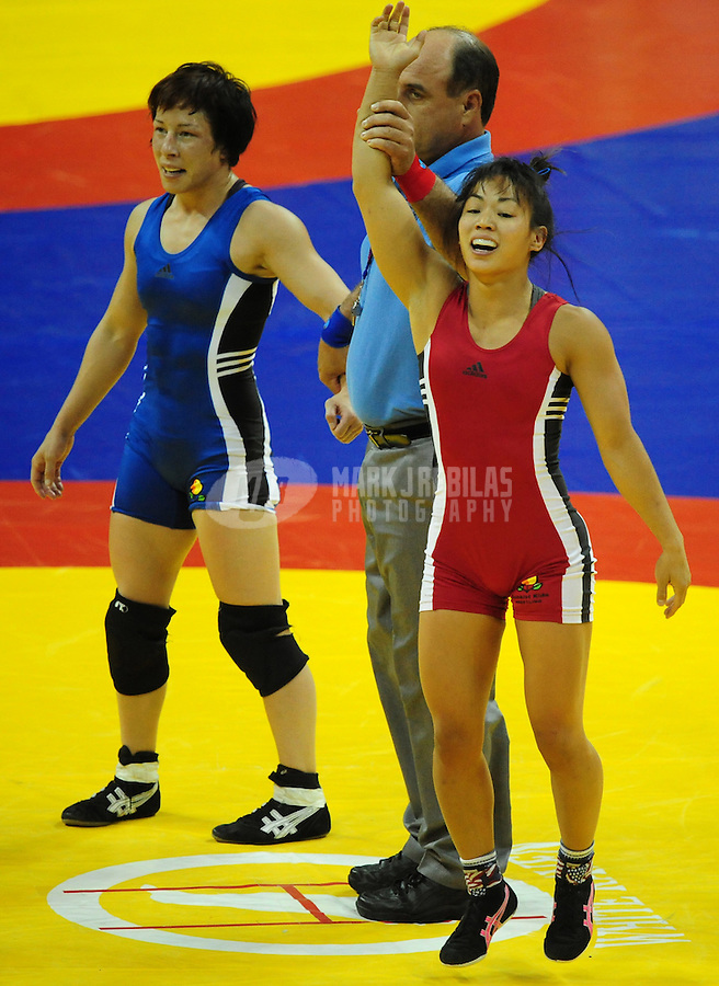 Jun 13, 2008; Las Vegas, NV, USA; Clarissa Chun (red) celebrates after defeating Patrcia Miranda during the final in the womans 48kg class at the 2008 US Olympic Team Trials at the Thomas and Mack Center. With the win Chun qualified for the Olympics. Mandatory Credit: Mark J. Rebilas-