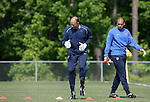 Kasey Keller (center) works his way through a drill as Tim Howard (r) watches on Saturday, May 20th, 2006 at SAS Soccer Park in Cary, North Carolina. The United States Men's National Soccer Team held a training session as part of their preparations for the upcoming 2006 FIFA World Cup Finals being held in Germany.