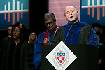 Rev. Patrick J. McDevitt, C.M., associate professor, offers an invocation Saturday, June 10, 2017, during the DePaul University College of Education commencement ceremony at the Rosemont Theatre in Rosemont, IL. (DePaul University/Jeff Carrion)
