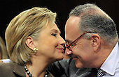 Washington, DC - January 13, 2009 -- United States Senator Chuck Schumer (Democrat of New York), right, gets a thank-you kiss after introduceing his colleague, United States Senator Hillary Rodham Clinton (Democrat of New York), left, as the United States Senate Foreign Relations Committee conducts a confirmation hearing for her as United States Secretary of State in Washington, D.C. on Tuesday, January 13, 2009..Credit: Ron Sachs / CNP.(RESTRICTION: NO New York or New Jersey Newspapers or newspapers within a 75 mile radius of New York City)