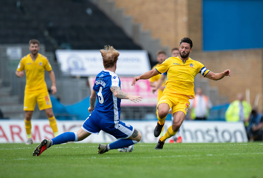 Gillingham's Connor Ogilvie (left) is tackled by Bolton Wanderers' Jason Lowe (right) <br /> <br /> Photographer David Horton/CameraSport<br /> <br /> The EFL Sky Bet League One - Gillingham v Bolton Wanderers - Saturday 31st August 2019 - Priestfield Stadium - Gillingham<br /> <br /> World Copyright © 2019 CameraSport. All rights reserved. 43 Linden Ave. Countesthorpe. Leicester. England. LE8 5PG - Tel: +44 (0) 116 277 4147 - admin@camerasport.com - www.camerasport.com