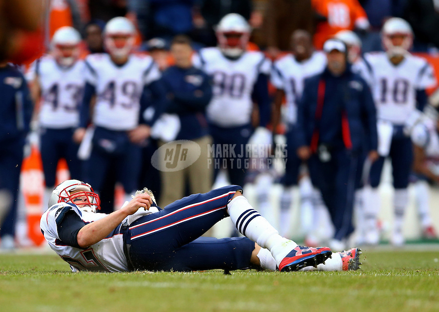 Jan 24, 2016; Denver, CO, USA; New England Patriots quarterback Tom Brady reacts on the ground after being tackled against the Denver Broncos in the AFC Championship football game at Sports Authority Field at Mile High. Mandatory Credit: Mark J. Rebilas-USA TODAY Sports