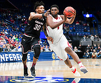 NWA Democrat-Gazette/CHARLIE KAIJO Arkansas Razorbacks forward Trey Thompson (1) drives the ball down the court as South Carolina Gamecocks forward Chris Silva (30) covers during the Southeastern Conference Men's Basketball Tournament, Thursday, March 8, 2018 at Scottrade Center in St. Louis, Mo.